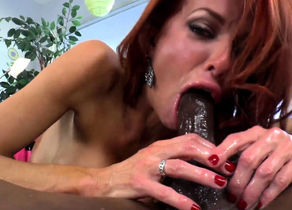 Ginger-haired dominatrix dickblowing..