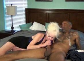 Platinum-blonde Grandmother plays with..