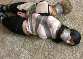 blb - 2 ladies duct taped..