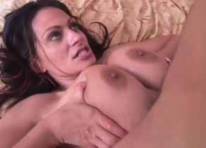 Huge-titted beauty plays with a..